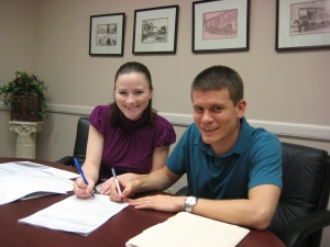 Signing our mortgage papers
