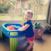 Playing with her water table